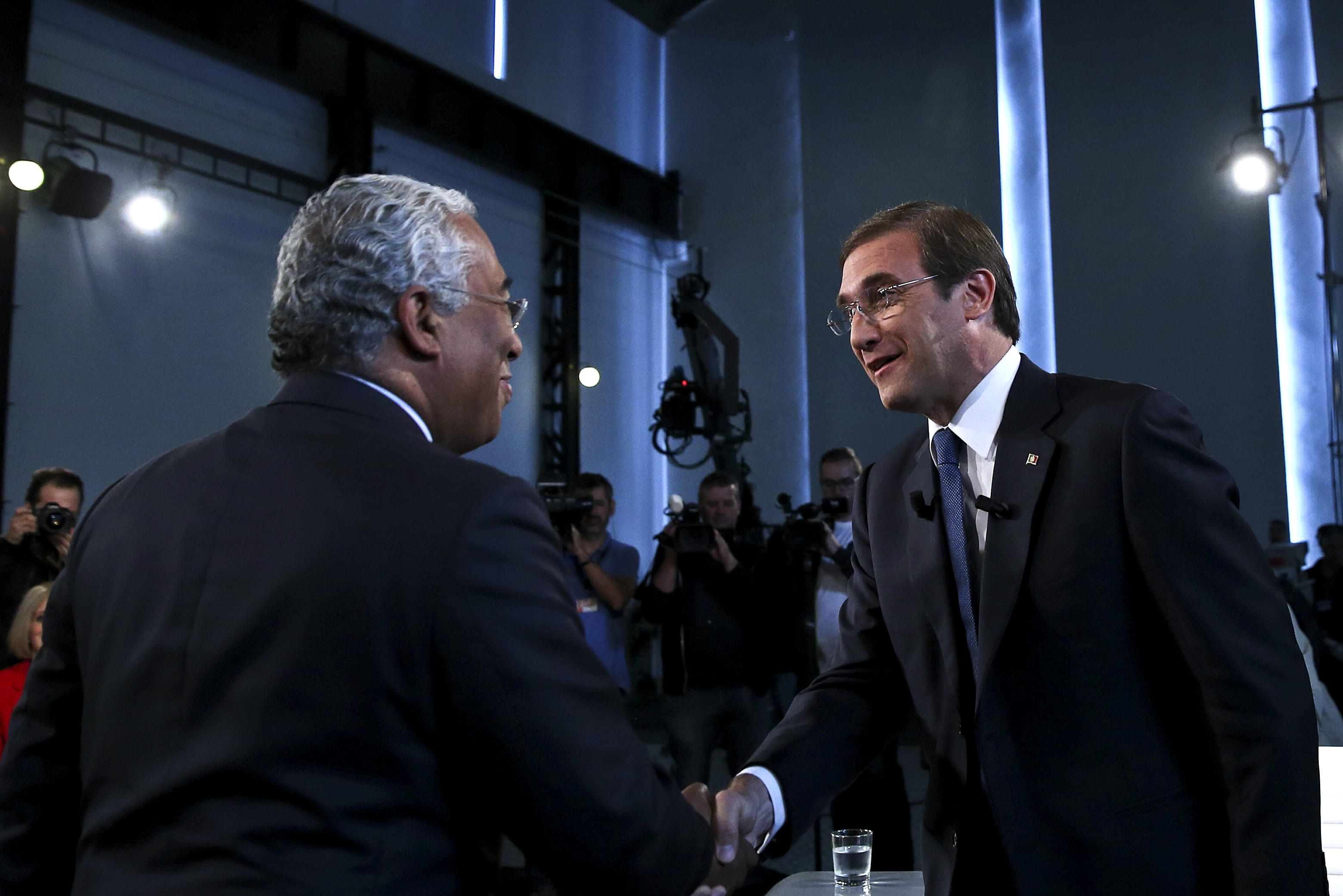 The Secretary-General of the Socialist Party (PS) and candidate Antonio Costa (L) greets the President of the Social Democrat Party (PSD), current Prime-Minister and candidate Pedro Passos Coelho (R), before their debate at the Electricity Museum in Lisbon, Portugal, 17 September 2015. The upcoming legislative election will take place on October 4th. It's the second debate between two leaders broadcasted simultaneously by the three major radios, Antena 1, Renascenca and TSF. TIAGO PETINGA/LUSA