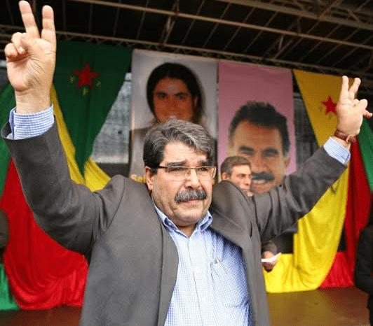 O Σαλίχ Μουσλίμ επισκέφθηκε πρόσφατα την Αθήνα και μίλησε σε εκδηλώσεις του Πολιτιστικού Κέντρου Κουρδιστάν και του Κέντρου Μεσογειακών, Μεσανατολικών και Ισλαμικών Σπουδών (ΚΕΜΜΙΣ). Είναι συμπρόεδρος του Κόμματος Δημοκρατικής Ενότητας (PYD), του κόμματος των Κούρδων της Συρίας, η επιρροή του οποίου αυξάνεται στο εσωτερικό του κουρδικού κινήματος
